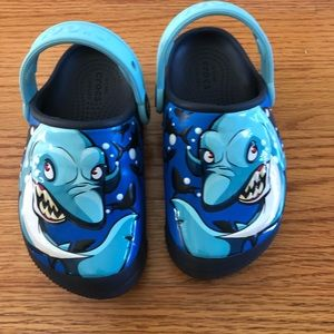 Crocs.  Boys sharks that light up size 10